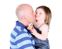 Handsome father kissing toddler daughter on the ch. Eek isolated onwhite Stock Photo