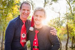 Handsome Festive Father and Son Portrait Outdoors royalty free stock photo