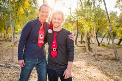 Holiday Festive Father and Son Portrait Outdoors. Handsome Festive Father and Son Portrait Outdoors royalty free stock image