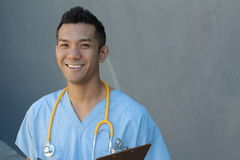 Handsome Filipino healthcare professional smiling. Handsome cute Filipino healthcare professional Royalty Free Stock Photography