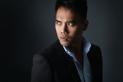 Handsome Filipino posing. Portrait of an attractive Filipino over a gray background Stock Image