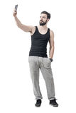 Handsome fit bearded young man taking selfie with mobile phone Royalty Free Stock Photography