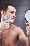 Handsome fit guy is caring of his appearance Stock Photography