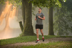Handsome Fit Man Running Outdoors Royalty Free Stock Photos