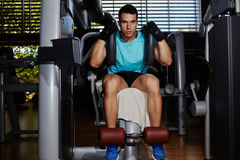 Handsome fit man working out with abdominal muscles Stock Photo