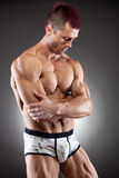Handsome  fit and muscular man Stock Photos