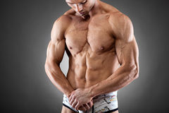 Handsome  fit and muscular man Stock Photography