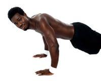 Handsome fit shirtless man doing pushups Stock Image