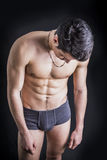 Handsome, fit shirtless young man wearing only underwear Stock Photos