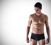 Handsome, fit young man in underwear on white Stock Image