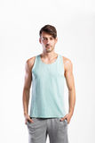 Handsome fitness man in blue tank top shirt, studio shot. Royalty Free Stock Image