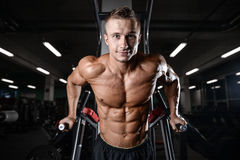 Handsome fitness model train in the gym gain muscle. Healthcare lifestyle sexy caucasian man bodybuilder work out naked body Stock Photo