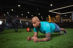 Handsome male African athlete working out at the gym royalty free stock photography