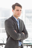 Handsome focused businessman with arms crossed Stock Photography