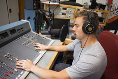Handsome focused radio host moderating Stock Photo