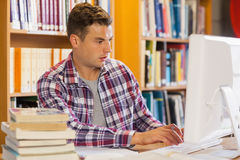 Handsome focused student using computer Stock Photos