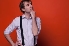 Man standing with hand on hip, propping chin and looking away royalty free stock photo