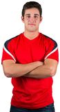 Handsome football fan in red jersey Stock Photo