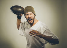 Handsome football player with ball Stock Image
