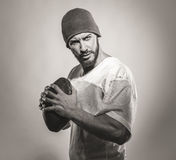 Handsome football player with ball Royalty Free Stock Image