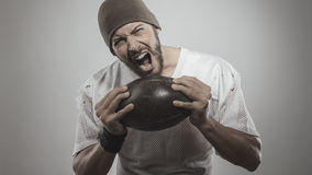 Handsome football player with ball Royalty Free Stock Images