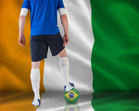 Handsome football player in blue jersey Royalty Free Stock Photo