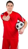 Handsome football player looking at camera Royalty Free Stock Images