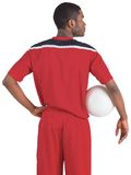 Handsome football player in red jersey Royalty Free Stock Image