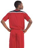 Handsome football player in red jersey Stock Photography
