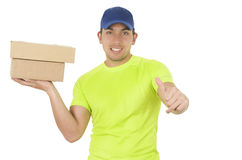 Handsome friendly brunette delivery man carrying Stock Images