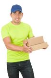 Handsome friendly brunette delivery man carrying Stock Photos