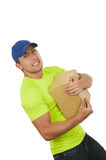 Handsome friendly latin courier man carrying box Royalty Free Stock Photography