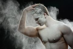 Handsome frozen man with a white powder on his Stock Images