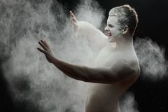 Handsome frozen man with a white powder on his Stock Photo