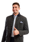 Handsome and funky sales man showing thumbs up Stock Photos