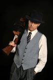 Handsome gangster man. In classic suit with gun stock photos