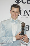 Handsome Gavin Creel Wins Broadway Acclaim. Gavin Creel holds his statuette at the 71st Annual Tony Awards in the media room at 3 West 51st Street, a couple Royalty Free Stock Photography