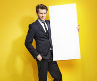 Handsome gentleman carrying white board Stock Image