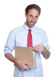 Handsome german businessman with file Stock Image
