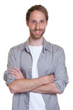 Handsome German guy with crossed arms Stock Images