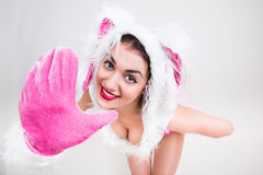 Handsome girl in rabbit costume feel happy say hi putting her hand forward Stock Photo