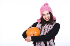 Handsome Girl in Scarf and Cap Holding Pumpkin Royalty Free Stock Photo