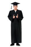 Handsome graduate guy student in mantle Stock Photography