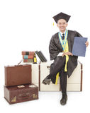 Handsome graduated student sitting and holding certificate. Full body portrait of handsome graduated student sitting and holding certificate isolated on white Stock Image