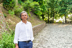 Handsome green eyes relaxed man near medieval walls Stock Photography