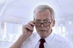 Senior man peering at the camera Royalty Free Stock Photography