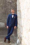 Handsome groom in a blue suit Stock Image