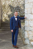 Handsome groom in a blue suit Stock Photo