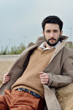 Handsome groom in coat in the nature Royalty Free Stock Image