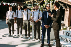Handsome groom and groomsmen on the wedding ceremony Stock Images